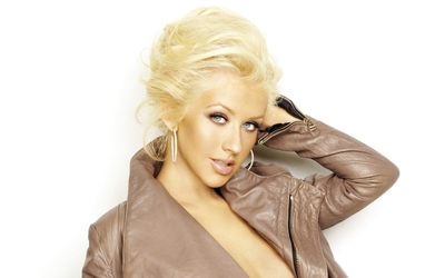 Christina Aguilera with an arm under her head wallpaper