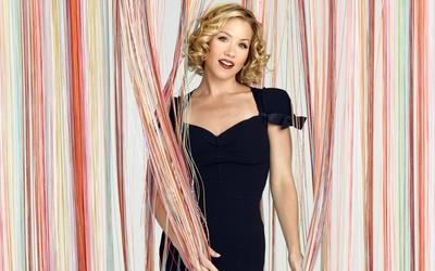 Christina Applegate in a dark blue dress wallpaper