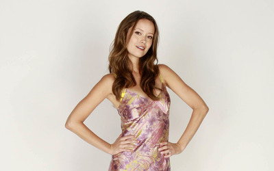 Cute Summer Glau with hands on her hips wallpaper
