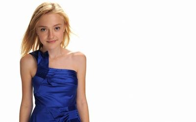 Dakota Fanning in an elegant blue dress wallpaper