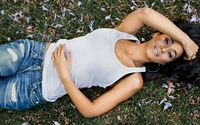 Emmanuelle Chriqui lying on the grass wallpaper 1920x1080 jpg