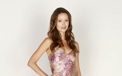 Friendly Summer Glau with a hand on her hip wallpaper