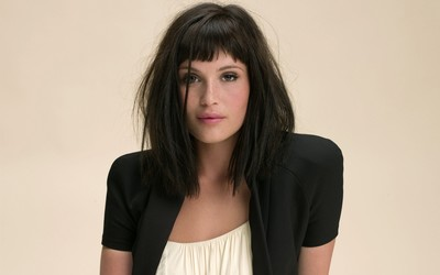 Gemma Arterton with a white top and a black jacket wallpaper