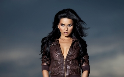 Inna with a brown leather jacket wallpaper