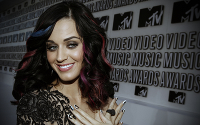 Katy Perry with blue and red strands wallpaper