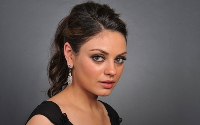 Mila Kunis with a black top wallpaper