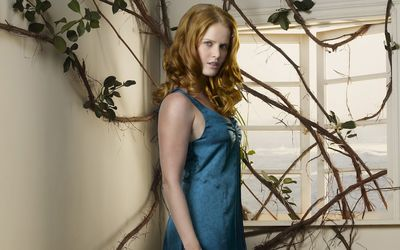 Mysterious Rebecca Mader under a plant wallpaper