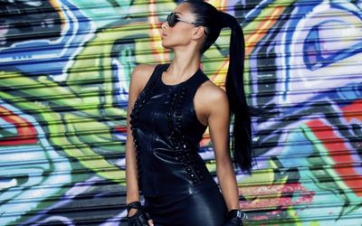 Nicole Scherzinger in a black leather suit wallpaper