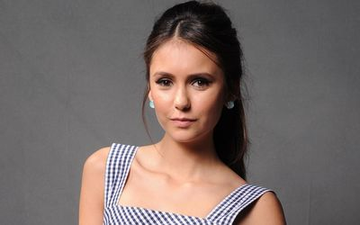 Nina Dobrev with a square pattern on her dress wallpaper