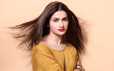 Prachi Desai with an orange top wallpaper