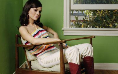 Rachel Bilson on a vintage armchair wallpaper
