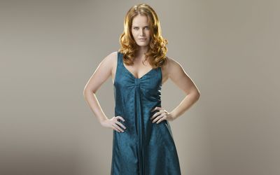 Rebecca Mader with blue dress wallpaper