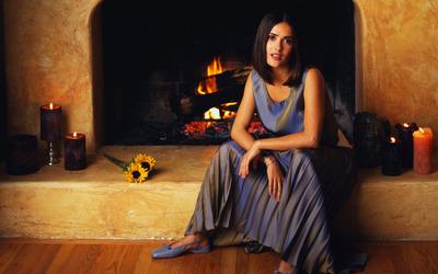 Salma Hayek in front of fireplace wallpaper