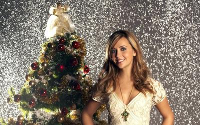 Samia Smith aside a Christmas tree wallpaper