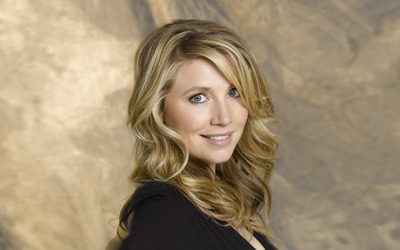 Sarah Chalke smiling in a black top wallpaper