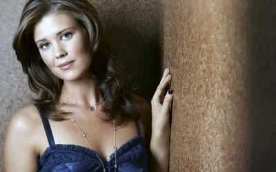 Sarah Lancaster with a dark blue top wallpaper