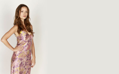 Serious Summer Glau with a hand on her hip wallpaper