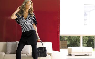 Silvie Van Der Vaart with a black bag wallpaper
