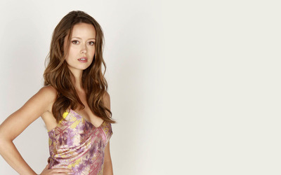 Summer Glau gazing with a hand on her hip wallpaper