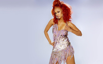 Tyra Banks redhead in a silk dress wallpaper