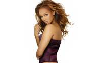 Tyra Banks with a purple top wallpaper 1920x1200 jpg