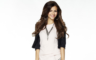 Victoria Justice with silver earrings wallpaper
