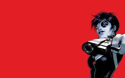 Domino with a pistol in her hand wallpaper