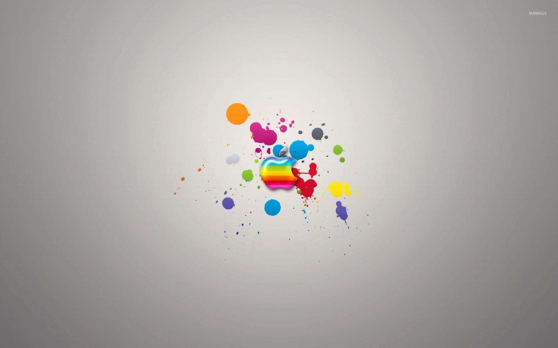 Colorful Apple On Paint Splash Wallpaper