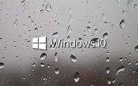 Windows 10 white text logo on a wet window wallpaper 2560x1600 jpg