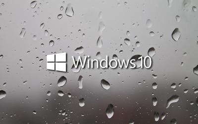 Windows 10 white text logo on a wet window wallpaper