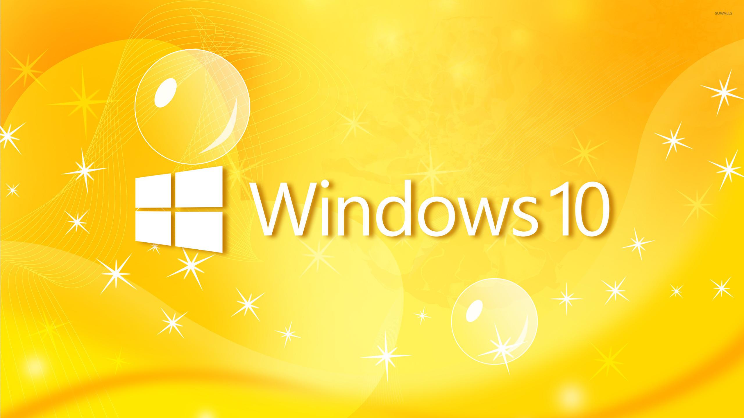 windows 10 text logo on yellow curves wallpaper computer