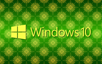 Windows 10 yellow text logo on green pattern wallpaper