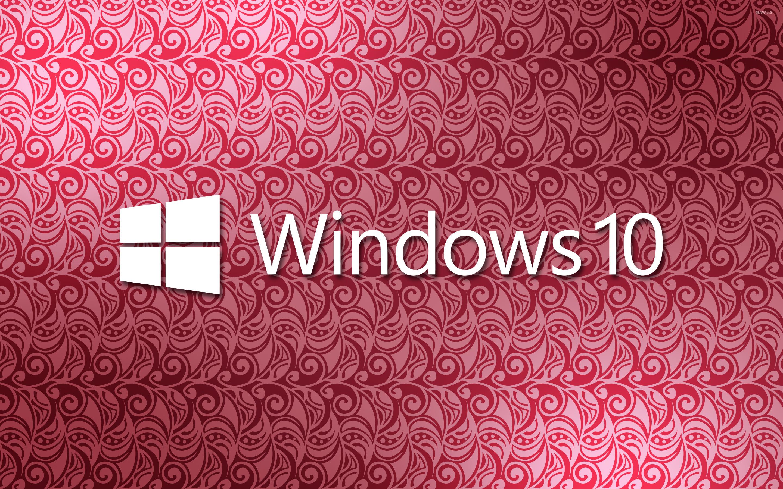 windows 10 white text logo on a pink pattern wallpaper