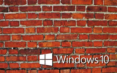 Windows 10 white text logo on the brick wall wallpaper
