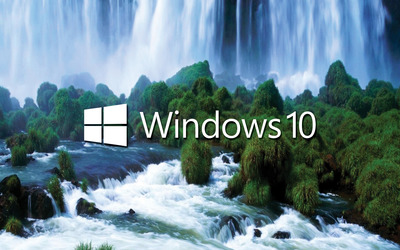 Windows 10 white text logo by the waterfall wallpaper