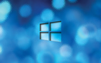 Windows 10 transparent logo on a blue bokeh wallpaper 1920x1200 jpg
