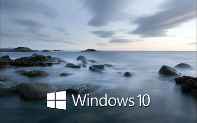 Windows 10 white text logo on the rocky shore wallpaper
