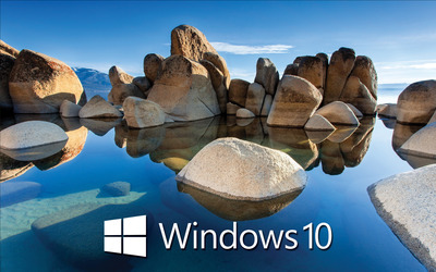 Windows 10 white text logo on the rocky lake wallpaper