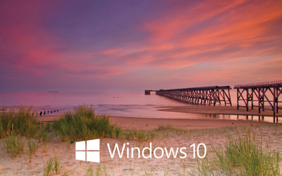 Windows 10 white text logo on the pier wallpaper