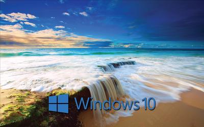 Windows 10 blue text logo on the golden beach wallpaper