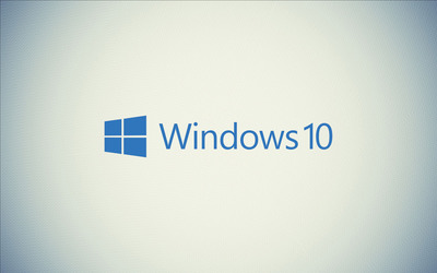 Windows 10 blue text logo on a white wall wallpaper