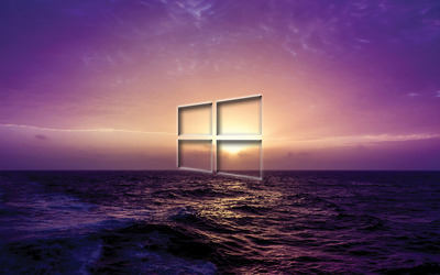 Windows 10 transparent logo on a purple sunset wallpaper
