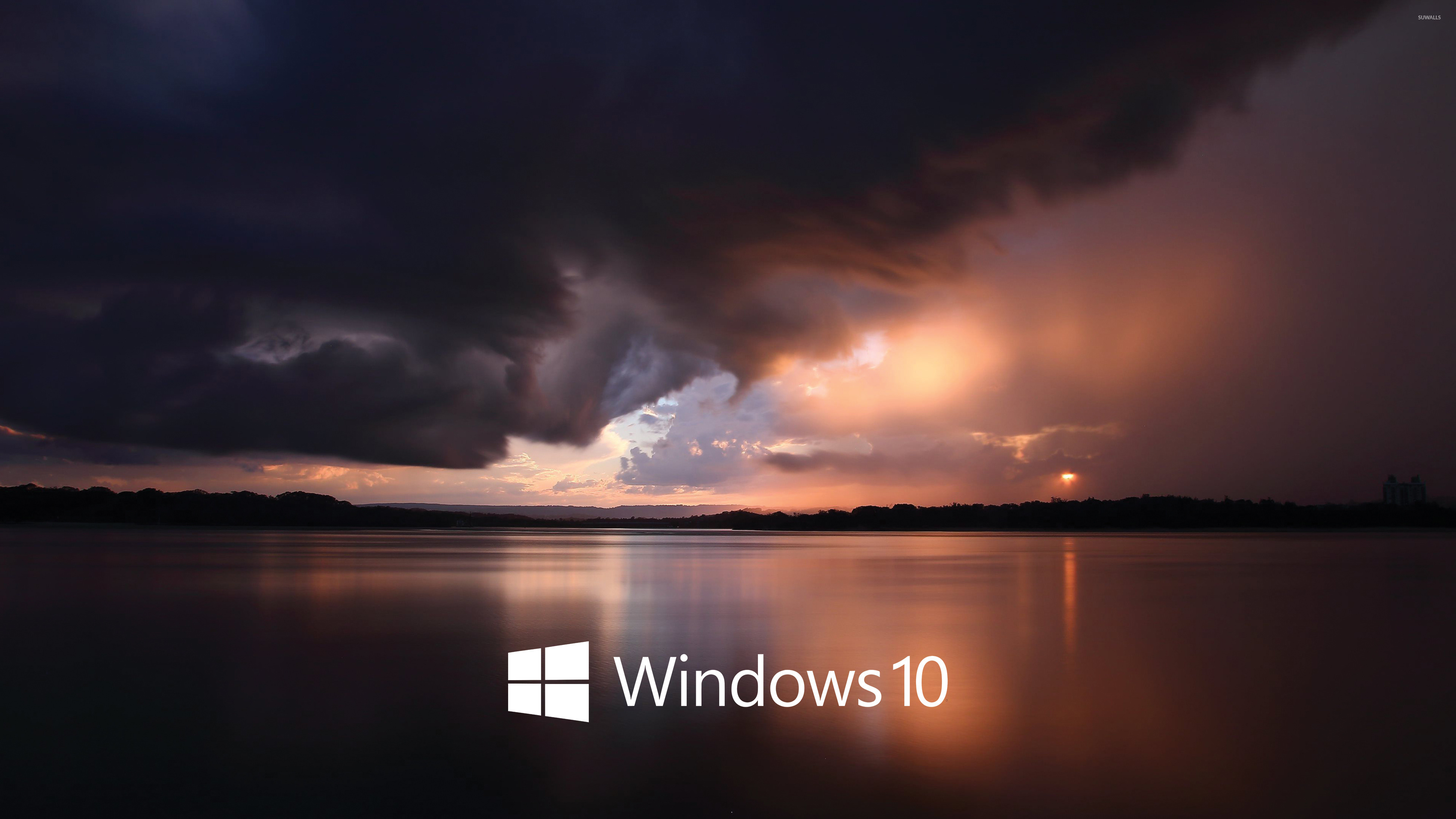 windows 10 white text logo over the stormy sea wallpaper - computer