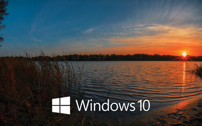 Windows 10 white text logo in the sunset wallpaper