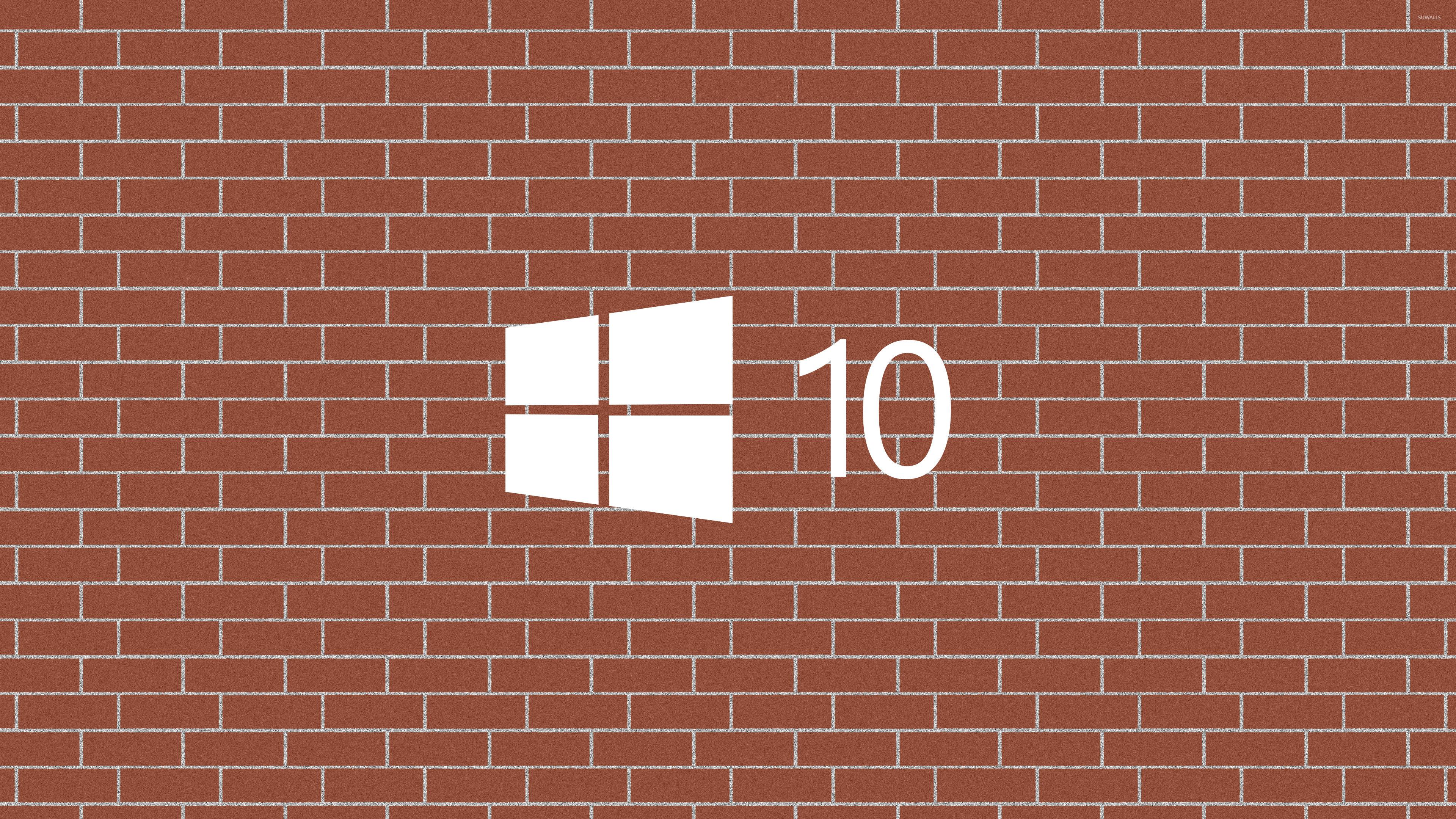 Windows 10 white logo on a brick wall wallpaper puter