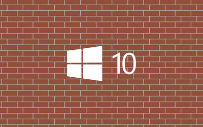 Windows 10 white logo on a brick wall wallpaper