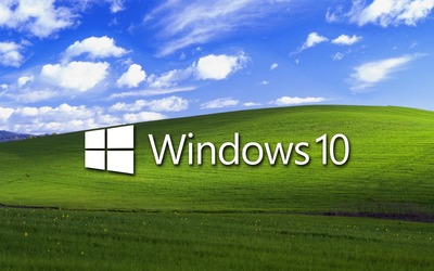 Windows 10 on a green field white text logo wallpaper