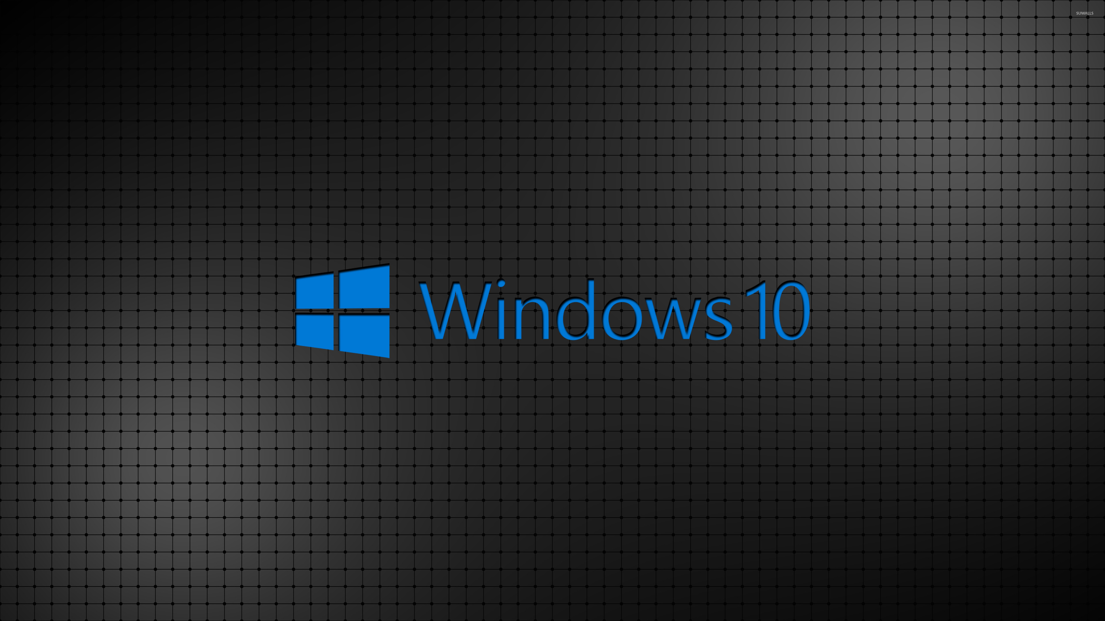 Windows 10 Blue Text Logo On A Grid Wallpaper
