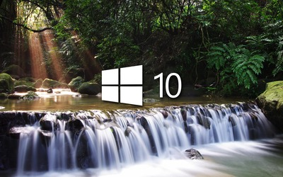 Windows 10 on a small waterfall white logo wallpaper