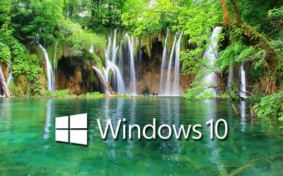 Windows 10 on a waterfall text logo wallpaper